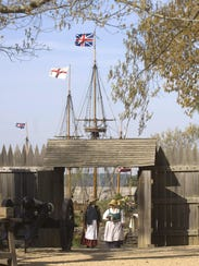 Two historical interpreters walk into the fort at Jamestown
