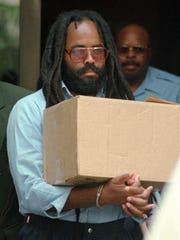 Mumia Abu-Jamal leaves Philadelphia's City Hall after a hearing in 1995.