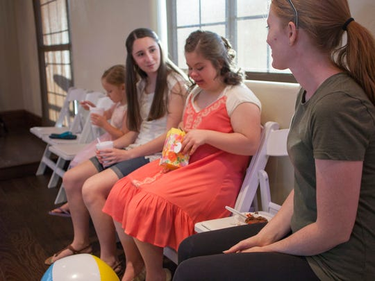 St. George resident Amber Graves opens gifts from friends