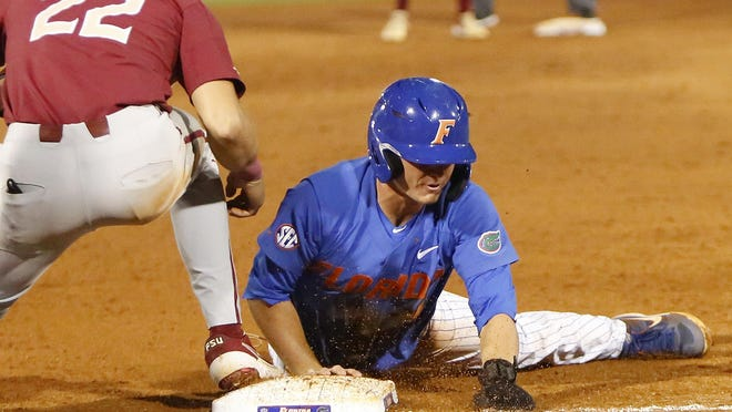 Florida Gators outfielder Jud Fabian slides safely into third base during a March 2019 game against Florida State in Gainesville. MLB.com has Fabian rated No. 4 overall for the league's draft in 2021. The Red Sox are expected to be in position to select him.