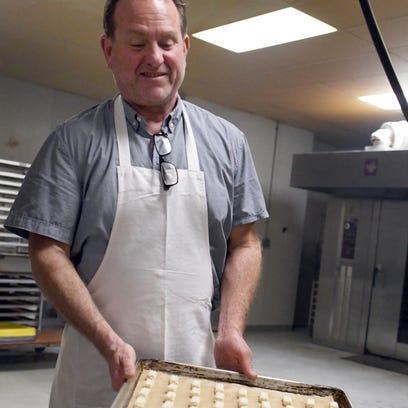 Jeff Flathau, owner of Flathau's Fine Foods, holds
