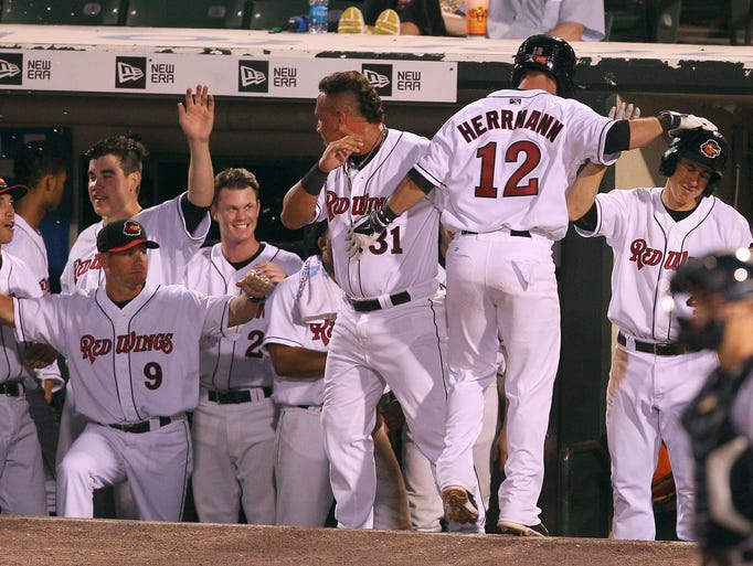 Chris Herrmann (12) is congratulated  in the dugout after hitting the 4th homer of the 5th inning.