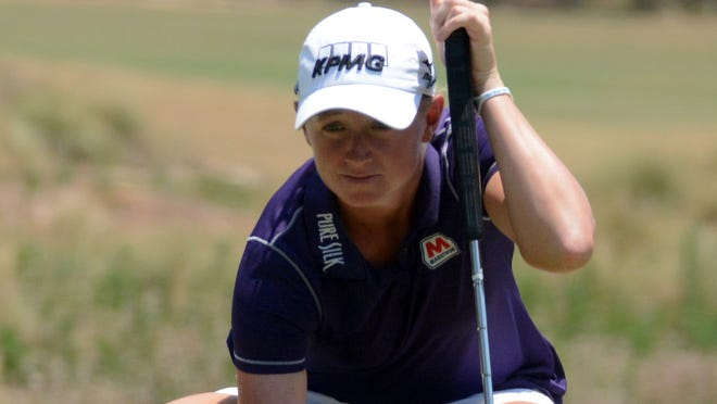 Stacy Lewis lines up a putt on hole number seven during the first round of the U.S. Women's Open at Pinehurst No. 2 Course.