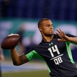 Mississippi State Bulldogs quarterback Dak Prescott throws  a pass during the 2016 NFL Scouting Combine at Lucas Oil Stadium.