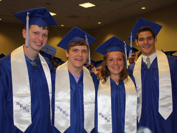 Clay Dunaway, Christian Drees, Emma Due and Patrick Helmig are all smiles before Simon Kenton High School's graduation ceremony May 31 at Northern Kentucky University's Bank of Kentucky Center.