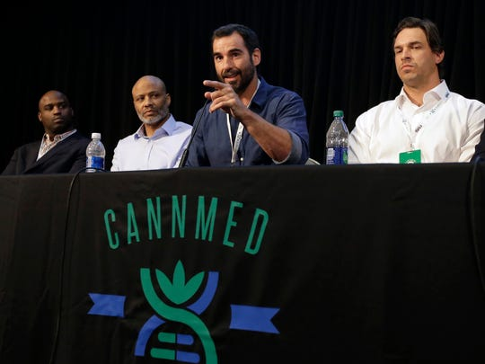 Former NFL football players, from the left,  Ricky Williams, Lance Johnstone, Nate Jackson, and Eben Britton participate in a conference on medical marijuana at Harvard on April 11.