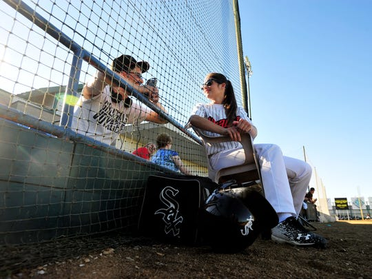 Voyagers bat girl Sarah Faulk visits with Phil Nehiley before the start of Wednesday night's game against the Orem Owlz at Centene Stadium.