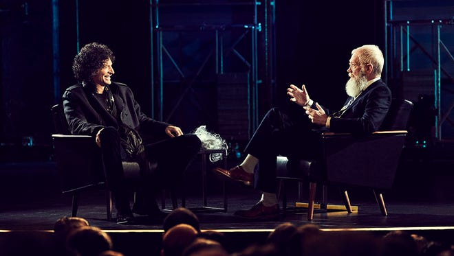 Howard Stern, left, chats with David Letterman.