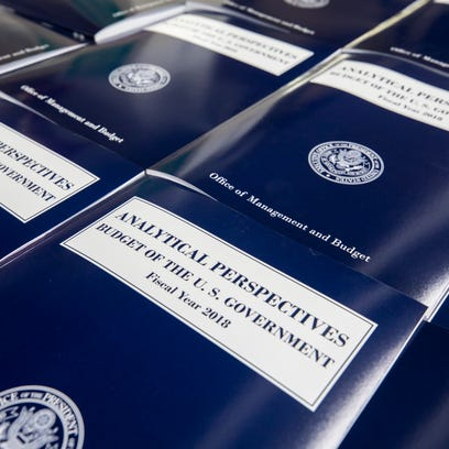 Copies of the FY2018 budget come off the production