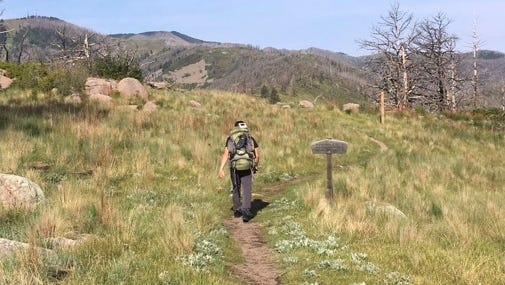 Rich Dozier starts out on his hike of the Crest Trail in Monjeau Peak.