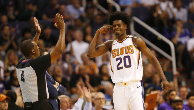 Phoenix Suns forward Josh Jackson (20) salutes after a 3-pointer against the Sacramento Kings during the third quarter at Talking Stick Resort Arena October 23, 2017.