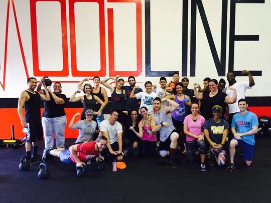 A class poses for a post-workout picture at Bloodline CrossFit.