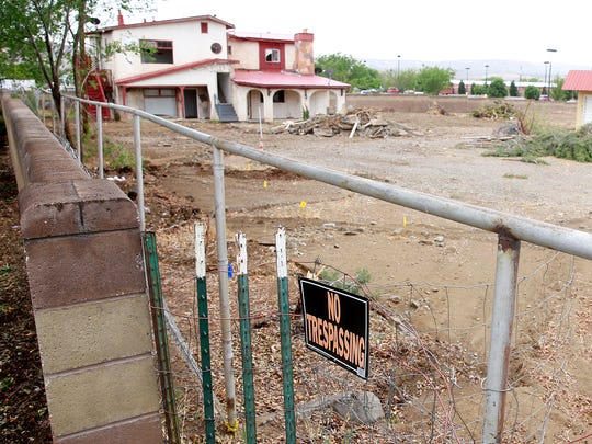 Construction has begun on a shopping center that will include Anytime Fitness and Durango Joe's, as seen on Friday next to the Walmart Supercenter at 1400 West Main Street.