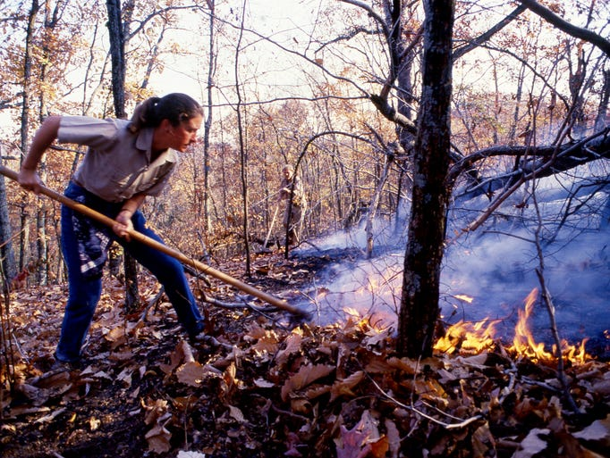 Metro Parks employees fight a fire Nov. 2, 1987, that