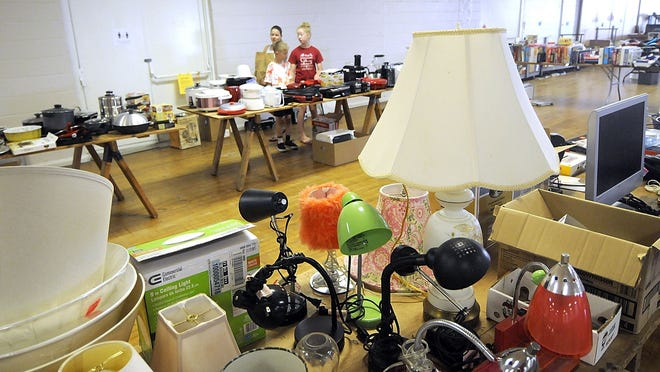 People look over the selection of items available at the Ashland County Cancer Association's Rummage Sale Friday. The event continues on Saturday at the fairgrounds from 9 a.m. to 3 p.m.