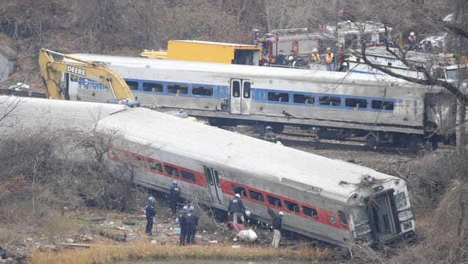 A rail crew works at the scene of the fatal Metro-North train derailment on Dec. 2, 2013, in the Bronx near the Spuyten Duyvil station, a day after the Metro-North passenger train derailed en route to New York City.