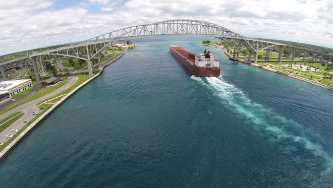 The Paul R Tregurtha freighter goes under the Blue Water Bridge in Port Huron