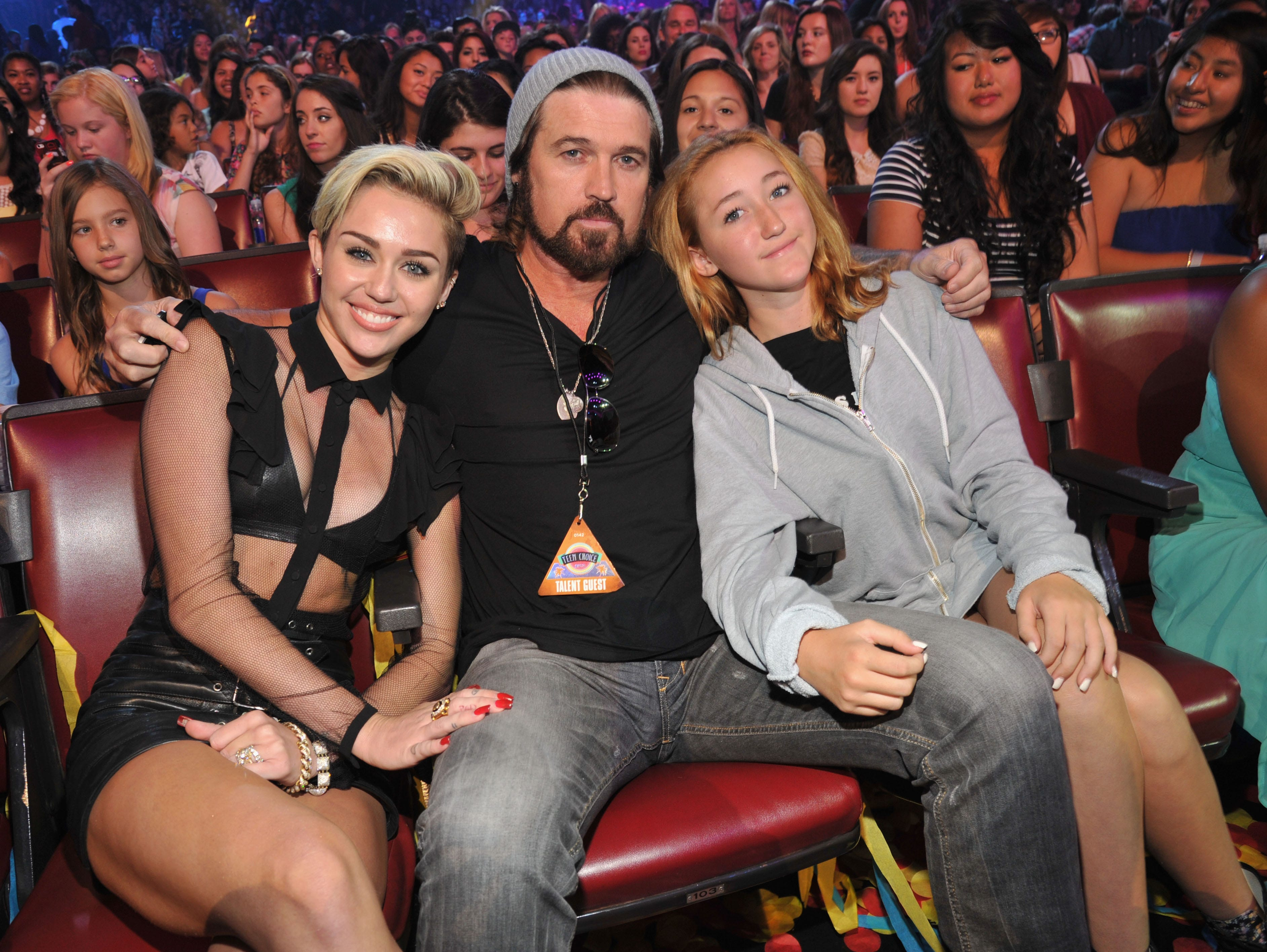 Actress/musician Miley Cyrus, musician Billy Ray Cyrus, and actress Noah Cyrus attend the 2013 Teen Choice Awards at Gibson Amphitheatre on August 11, 2013 in Universal City, California.