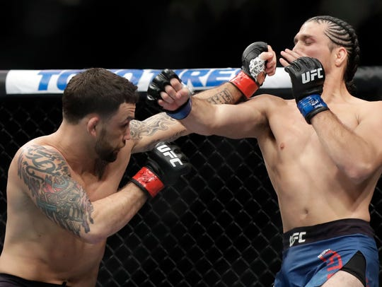 Frankie Edgar (left) and Brian Ortega fight during