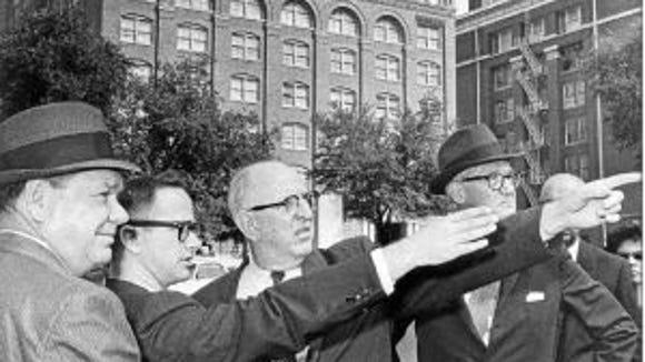John Sherman Cooper, right, in Dealey Plaza in Dallas.