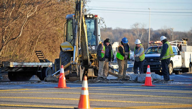 The personnel from the Metro Work Department works on the water main break at the Harding Road exit ramp off I-24 in Nashville, Tenn., Thursday, Jan. 8, 2015.