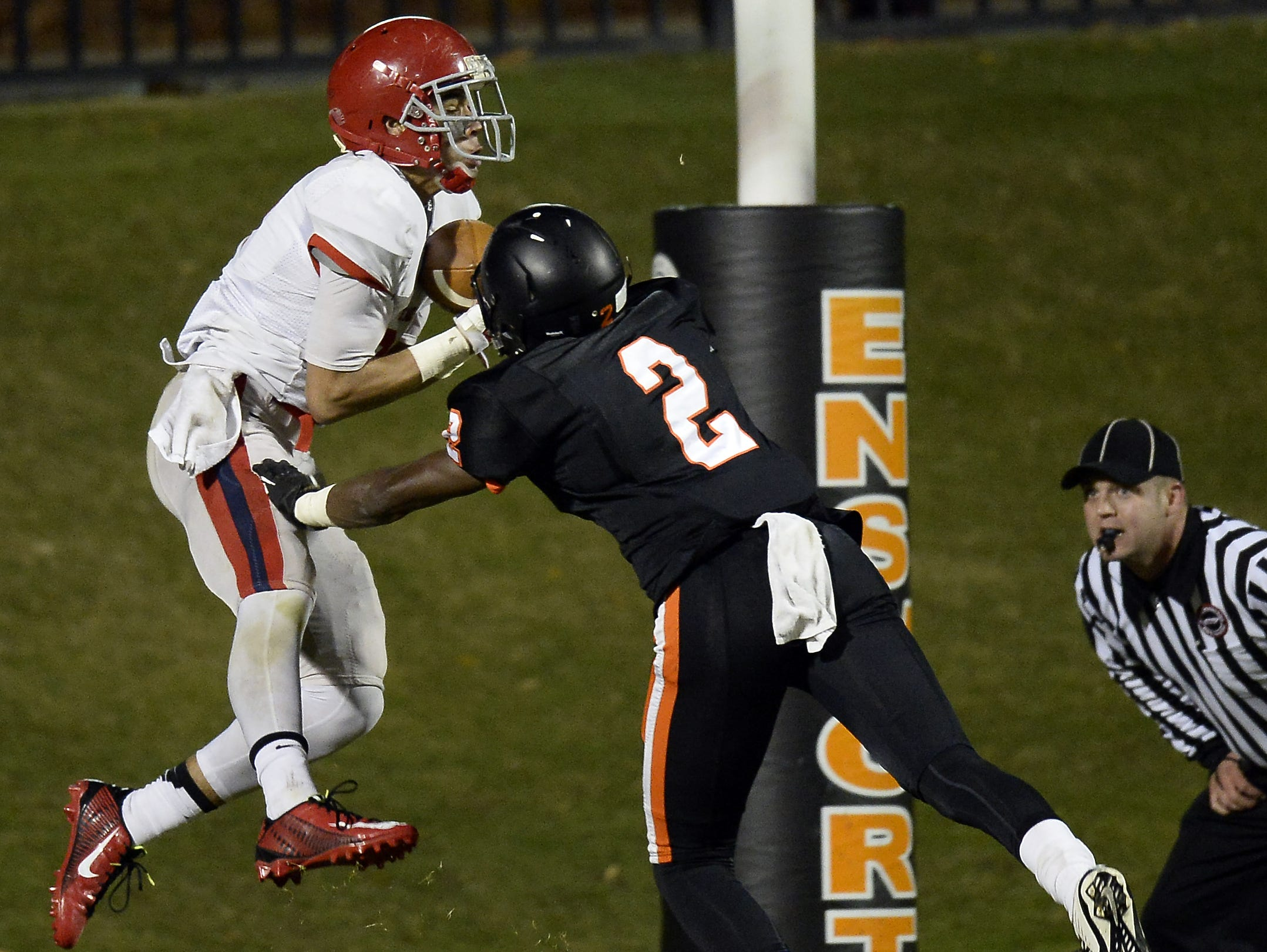 Brentwood Academy's Camron Johnson hauls in a touchdown over Ensworth's Rodney Owens (2).