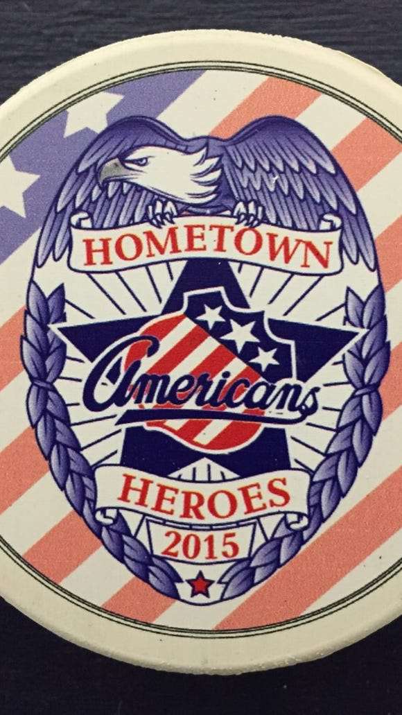 The special Hometown Heroes puck that will be sold for $10, with the money going to the Rochester Police Foundation.