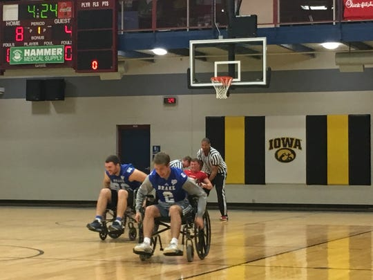 Drake players make their way down the court at the wheelchair basketball game.