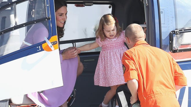 Duchess Kate and Princess Charlotte explore a helicopter before departing from Hamburg airport on the last day of royal tour of Poland and Germany on July 21, 2017 in Hamburg, Germany. Photo: Chris Jackson, Getty Images | Getty Images Europe.