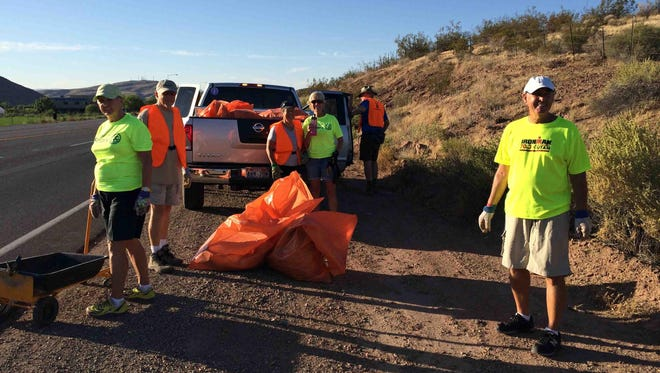 Members of the Dixie Sunrise Rotary Club clean up trash along Dixie Drive in St. George last weekend.