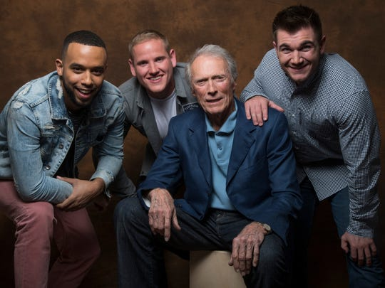 Director Clint Eastwood, center, found real-life heroes Anthony Sadler, left, Spencer Stone and Alek Skarlatos were the best stars for his film 'The 15:17 to Paris.'