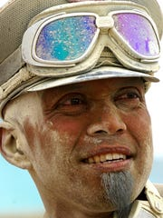 Jeff Rocke, 44, of Reno, watches the action at Burning Man following an intense dust storm.
