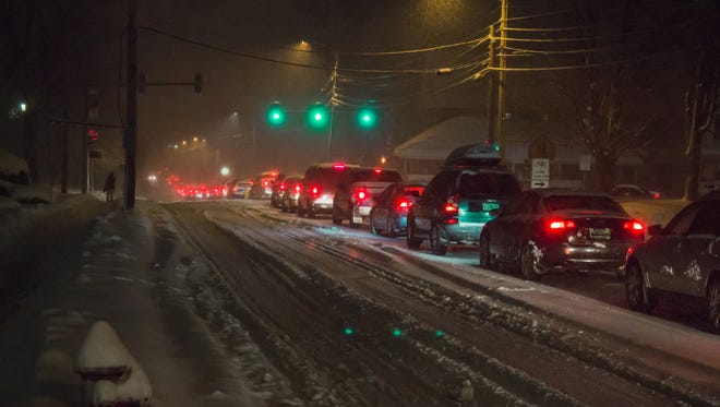 Traffic stands still on Colchester Avenue at the intersection of East Avenue in Burlington during a winter storm on Dec. 10, 2014.