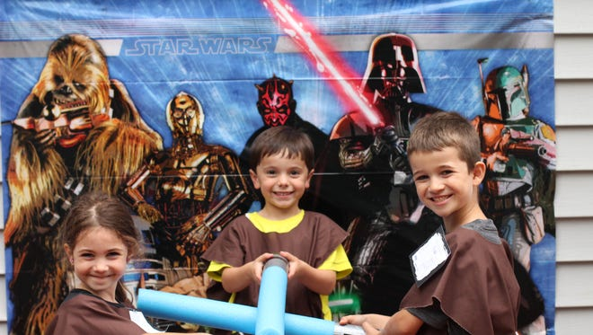 """For my son's sixth birthday, """"Star Wars"""" themed,  I made the Jedi cloaks and pool noodle light sabers. I bought the fabric on sale at a craft store and cut pool noodles from the dollar store in half. Duct tape and electrical tape complete the handles."""