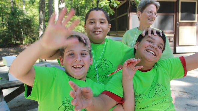 Children at Camp Firefly, which was held in Medford recently, have fun with each other.