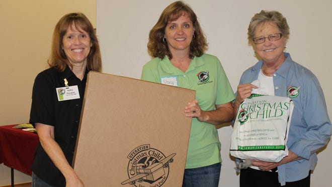 From left are Operation Christmas Child Distribution Center Coordinator Kathy Douglas with volunteers Stacy Gorman (Las Cruces) and Allie Bryant (Deming).