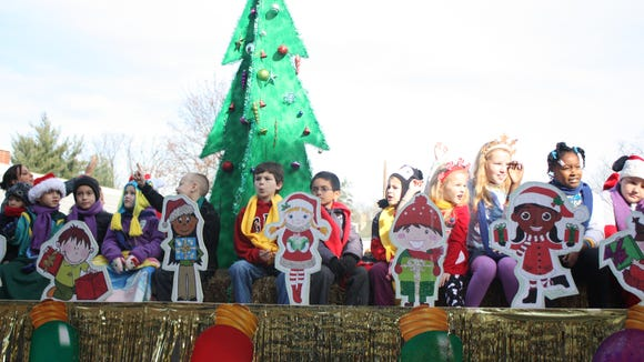 Holiday float features local children at the 2014 parade