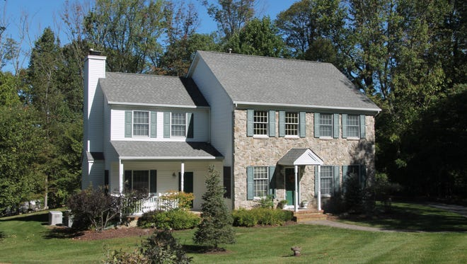 This stone-front Colonial at 7 Harber Drive in Lebanon Township will be open from 1 to 4 p.m. today.