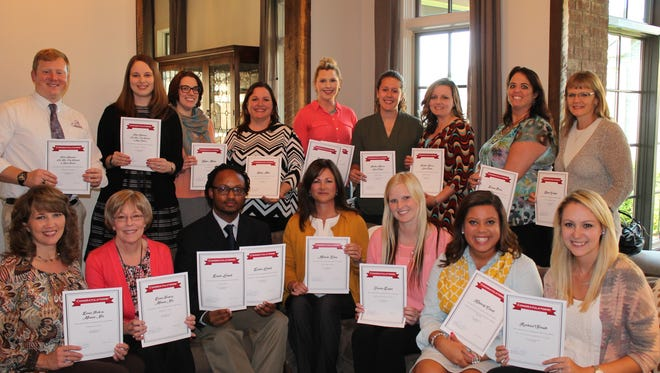 The 2015 City Schools Foundation grant winners are (seated, left to right) Melanie Noe, Diana Polk, David Lockett, Michelle Eaton, Jessica Dozier, Kimberly Carrell, Rachael Slough, and (standing, left to right) Luke Dickerson, Kelley Kleppinger, Kayla Mullen, Kristy Mall, Bess Turner, Laura Caylor, Heather Knox, Donna Beers and Karen Godwin.
