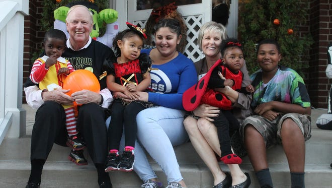 Dr. Jim Ramsey and Jane Ramsey celebrate Halloween with children from Family Scholar House.