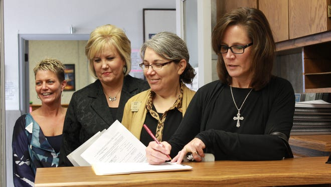 Incumbent Canda J. Reese, right, filed for county and circuit clerk at the Baxter County Courthouse shortly after noon Monday when the filing period opened for candidates in Arkansas. Reese, a Republican, was the first to file in Baxter County on Monday followed by County Treasurer Jenay Mize, County Assessor Jayme Nicholson and County Collector Teresa A. Smith.