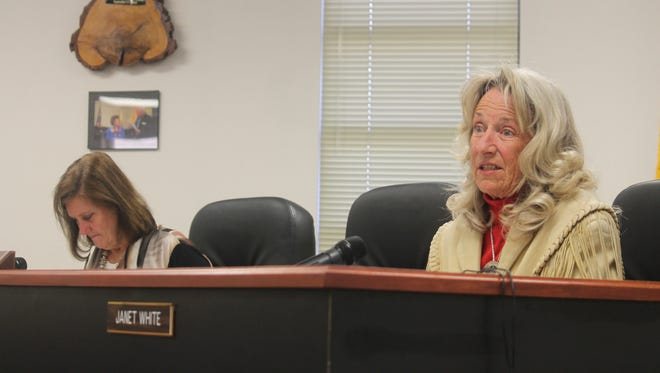 County Commissioners Susan Flores (left) and Janet White (right) respond to a question regarding their lawsuit with the Lincoln National Forest at their regualr County Commission meeting on Nov. 12 at the County Administration Building.