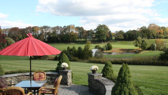From the patio of this 13-room Readington Colonial, you can see the Stanton Ridge golf course and its fountain and pond near the seventh hole.