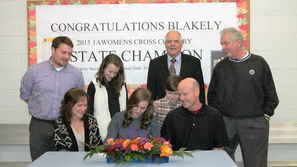 Highlands senior Blakely Moore has signed to run college cross country and track for Lee (Tenn.).