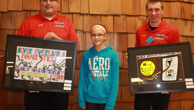Elkhart Lake-Glenbeulah students won state awards for their fire safety posters at the 2015 Wisconsin State Firefighters Convention. Lauren M. Schneider, middle, was awarded first place. The contest is sponsored by the Elkhart Lake Fire Department. Rob Schmidt, left, and Cody Schmidt, right, are Elkhart Lake firefighters.