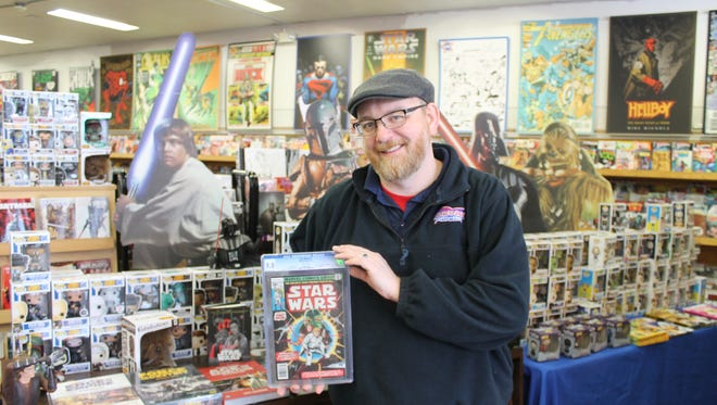Robert Young, owner of Borderlands Comics and Games in Greenville, displays the store's copy of Marvel Comics Group's Star Wars #1, valued at approximately $2,000.