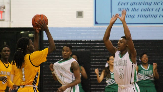 """Fair Park senior Donny Perkins, Jr., looks to make a play against Bossier's Larry Robinson III in the championship of the """"Doc"""" Edwards Invitational Wednesday night at Airline High School."""