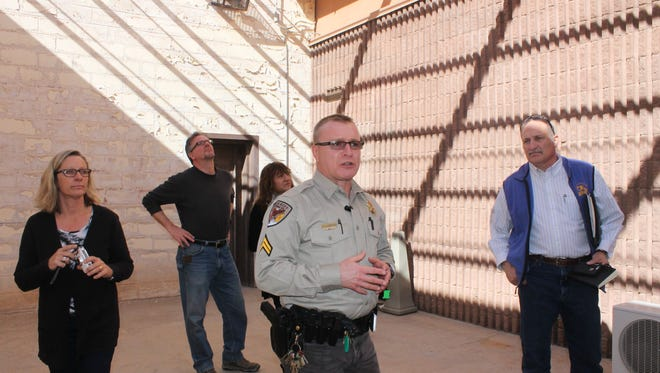 Otero County Sheriff's Office Supervisor Cpl. Theo Livingston conducts a tour of the 12th Judicial District Attorney Court House, 1000 N New York Ave. to a group of engineers Friday morning.