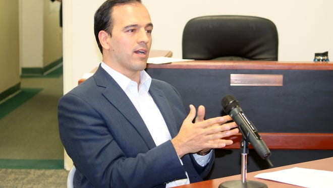 Javier Ruiz, Co-founder and Vice-president of Border Solar, speaks at the Feb. 11 regualr County Commission meeting about the latest on the solar site at the Otero County Prison Facility.