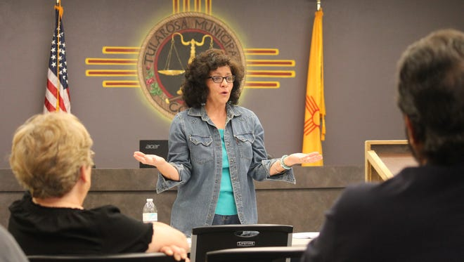Tina Cordova, co-founder of the Tularosa Basin Downwinders Consortium, talks to residents about the cancellation of the TV series Manhattan and the health surveys they are circulating around the community.